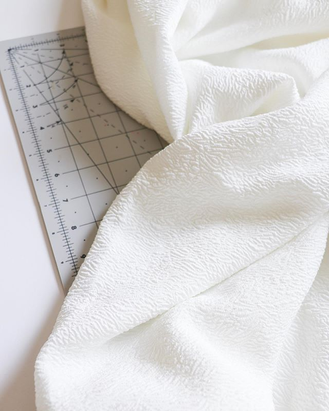 I'll be sharing our pink floral outfits tomorrow, but in the mean time, here's a peek at what's next up on my sewing table! This textured ivory crepe will be my first project for @minervacrafts, and I'm pretty pumped for the idea I have for it! #isew #imakefashion #minervamakers #fabriclove #imakemyclothes