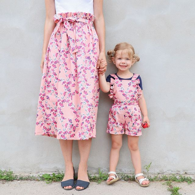 Mommy and me twinning, always and forever 👯‍♀️. I mentioned that I was going to keep my garment pretty simple with this fabric, and there's nothing more simple than and elastic waist gathered skirt! I added the paper bag waist and matching sash belt for a bit more interest, but still a pretty simple design. Simple, but definitely not boring, because this fabric is soooo gorgeous. It doesn't need too much fuss to shine. But let's face it anyway, those cute little overalls are the real star of the show. Some cute little ruffles to match my ruffled waist and some teeny tiny pockets to hold her Paw Patrol favorites and OMG I can't handle her cuteness 😭. . Fabric: cotton sateen from @measurefabric  My skirt: self drafted  P's overalls: @hellodearkids . #pennyandmommymatchagain #mommyandmestyle #twinning #mommyandme #hollyshandmade #pennyshandmadewardrobe #isew #imakefashion #memade #memadeeveryday #handmadewardrobe #imakenyclothes #sewingforkids #madebymama #mamamade