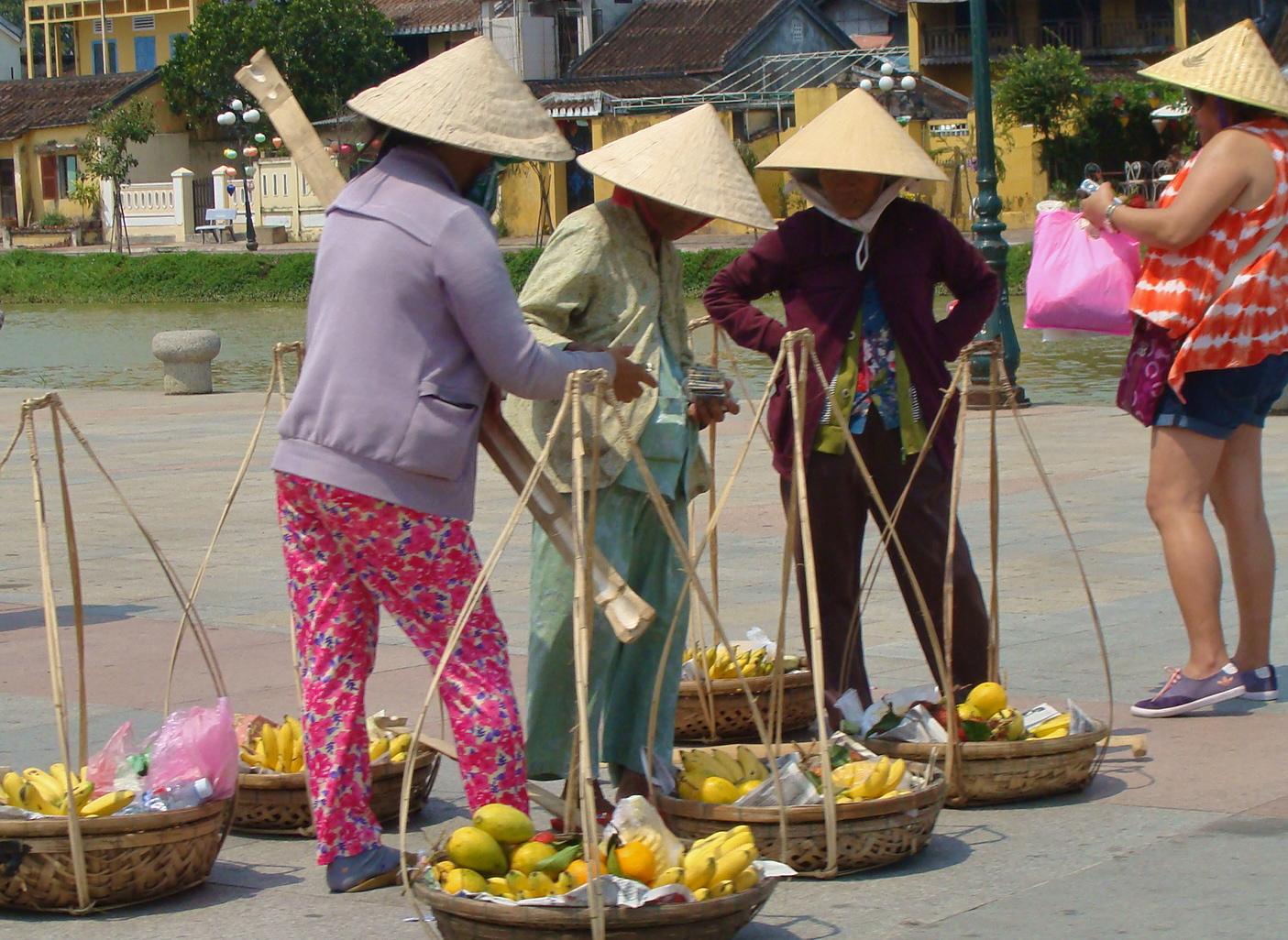Selling their fruit in Hoi An, Vietnam.