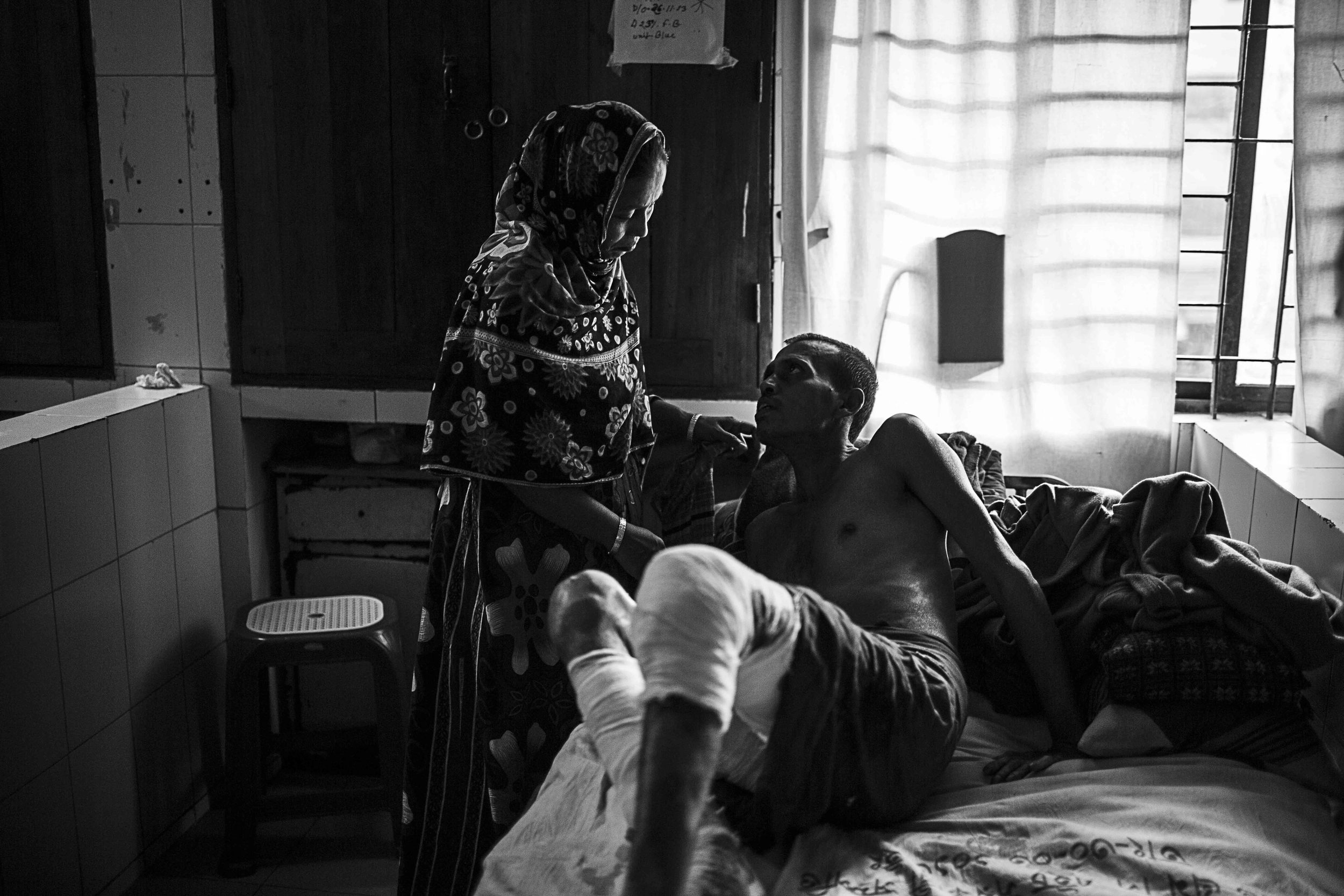Mohammad Rubel Mia and Nasima Begum share an intimate moment between the chaos of the Burns Unit.