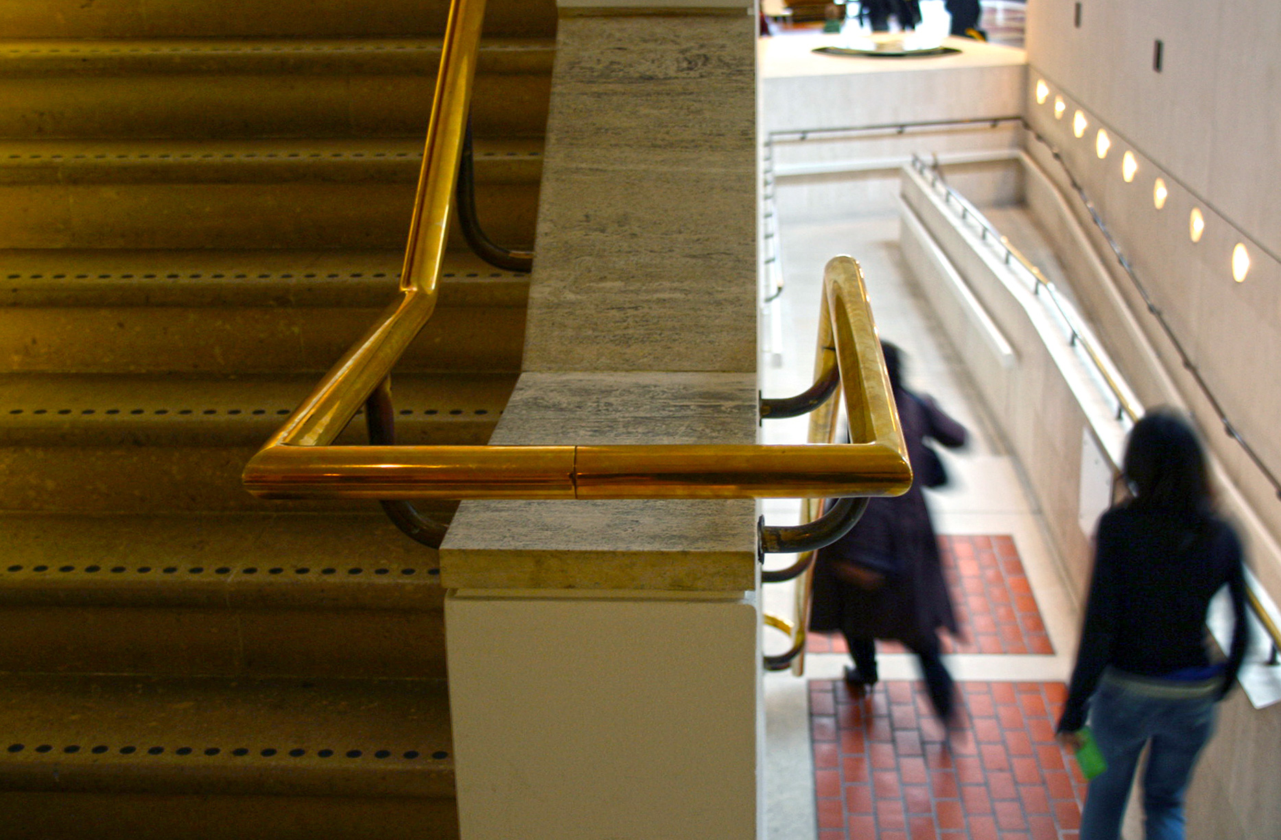 Brass handrails at the British Library in London. Note that this building predates current regulations regarding stairs, landings and ramps!