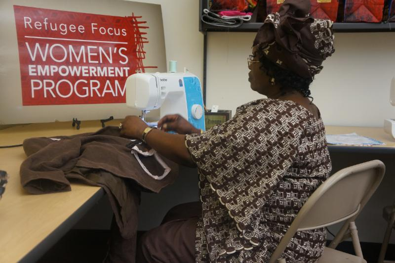 Bingi Shabani, from the Democratic Republic of Congo, is making a jacket that will be modeled in the upcoming Women's Fashion Show and Tea.