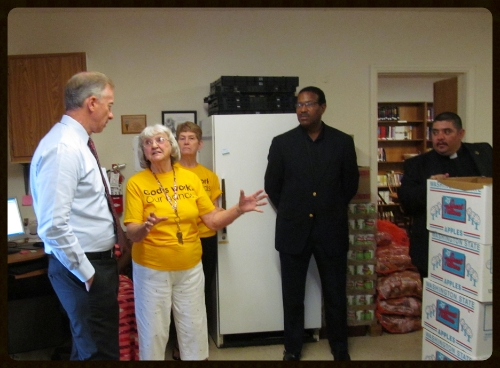 Our lead food pantry volunteer, Darlene Roe, explaining our food box distribution process.