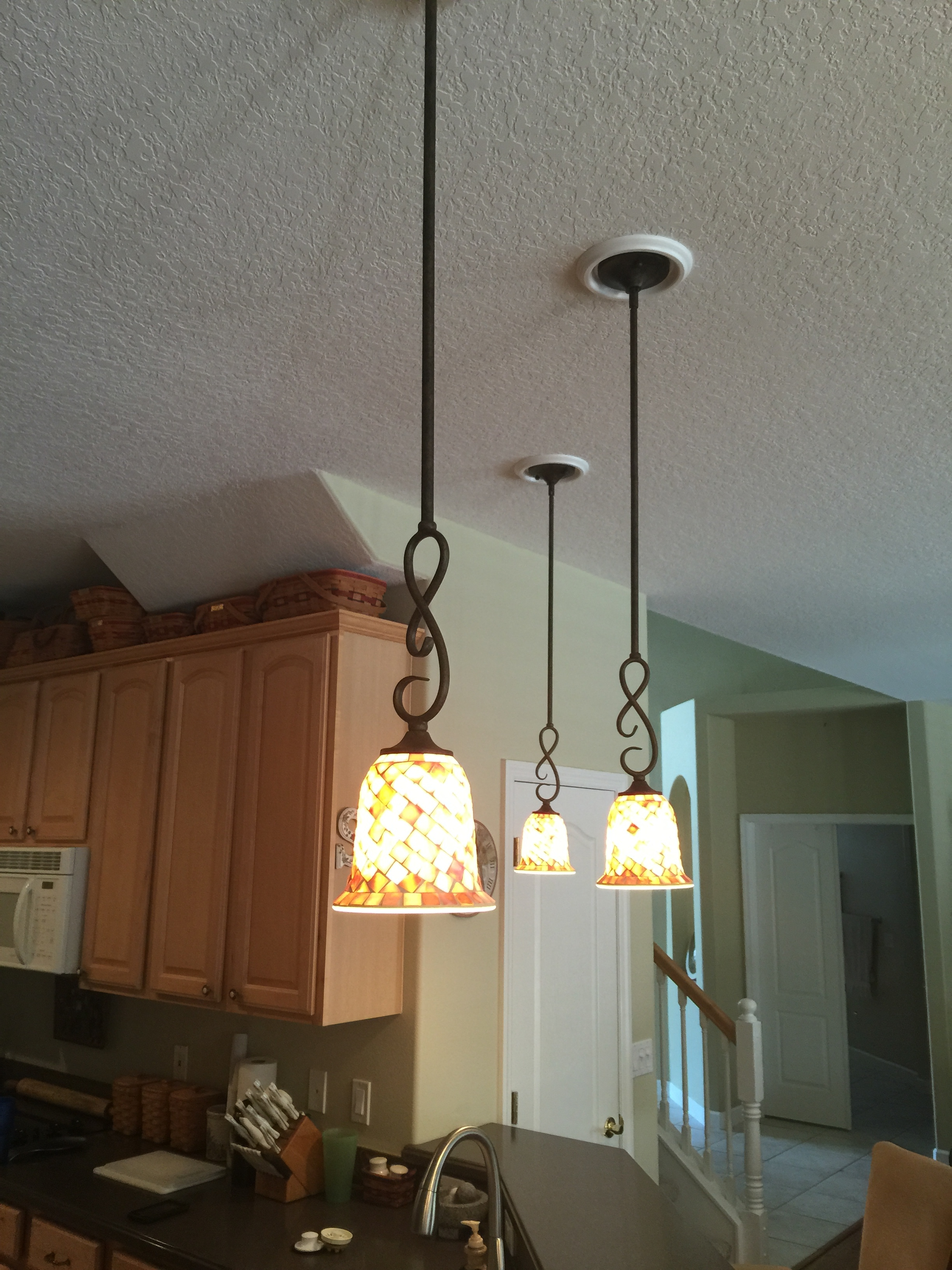 Recess cans converted into pendant lights.