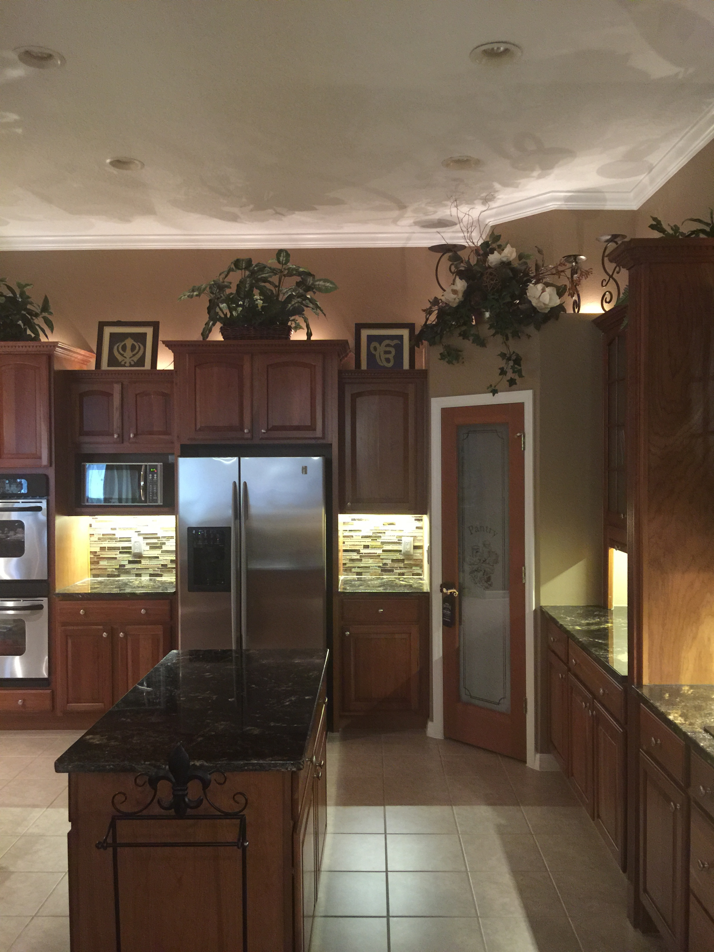 Low voltage lighting, accent above the cabinets and task lighting below.