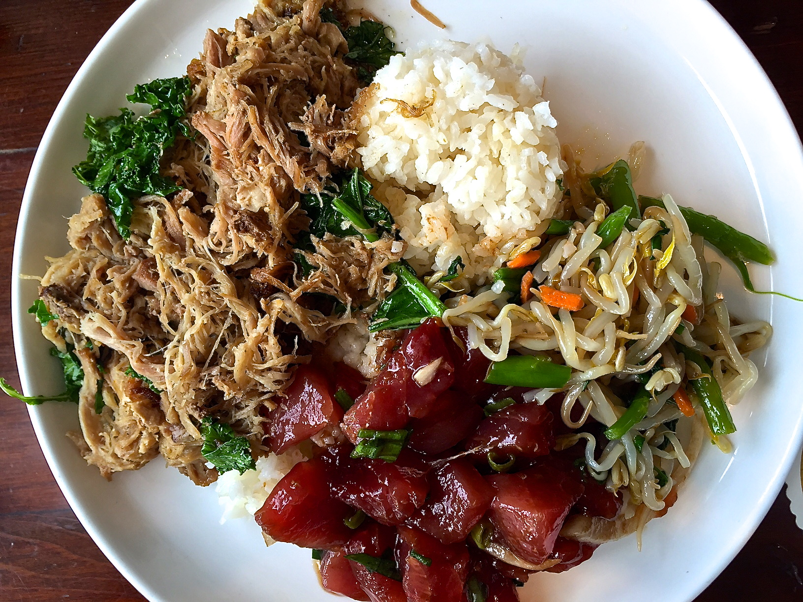 Kalua pig with poke tuna, stir fried vegetables.