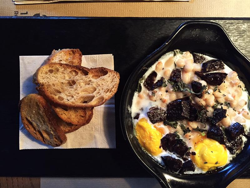 Catalan blood sausage with baked eggs, beans-Taranna restaurant, Barcelona