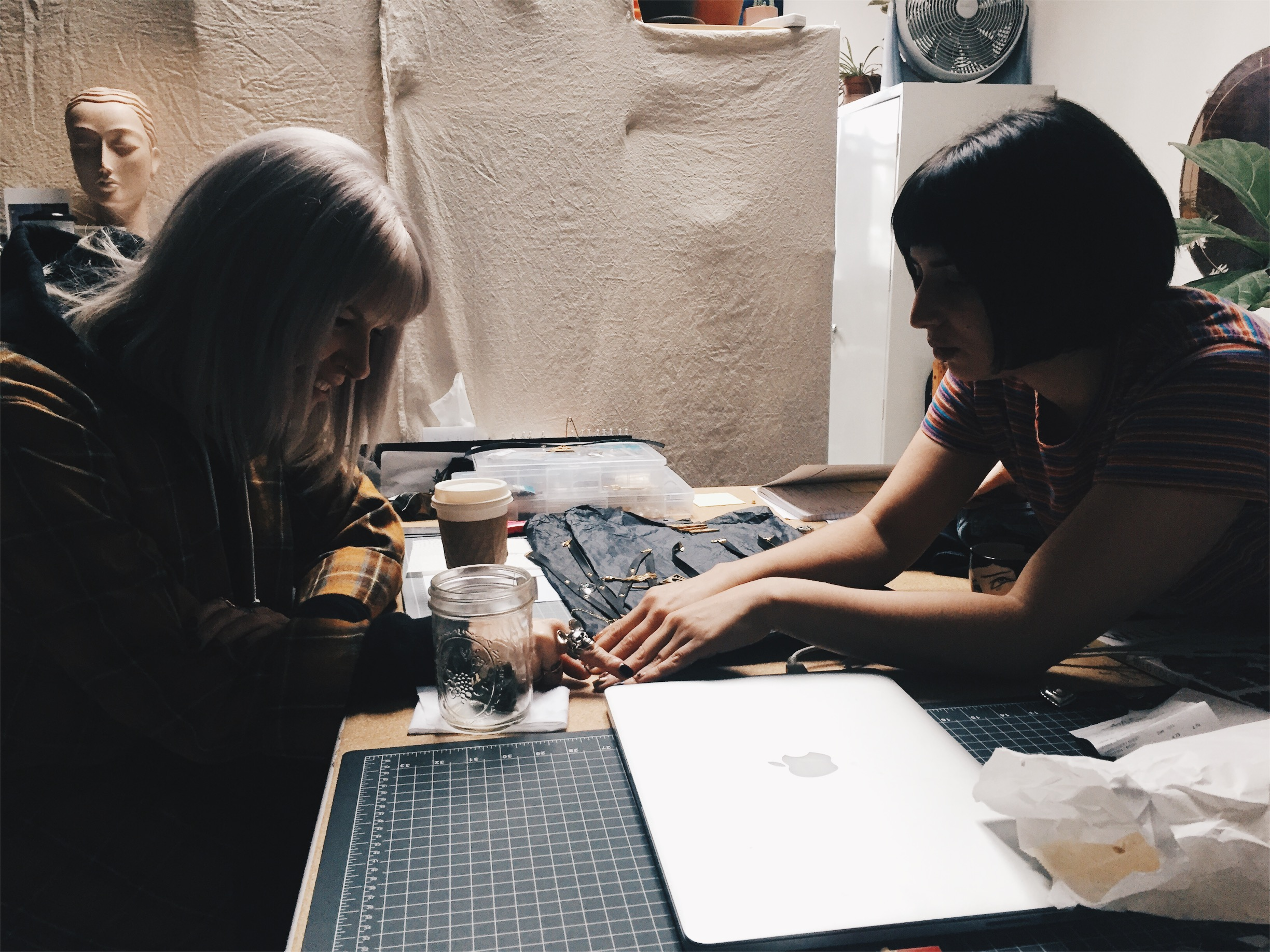 Giselle and Dyanna working in the studio