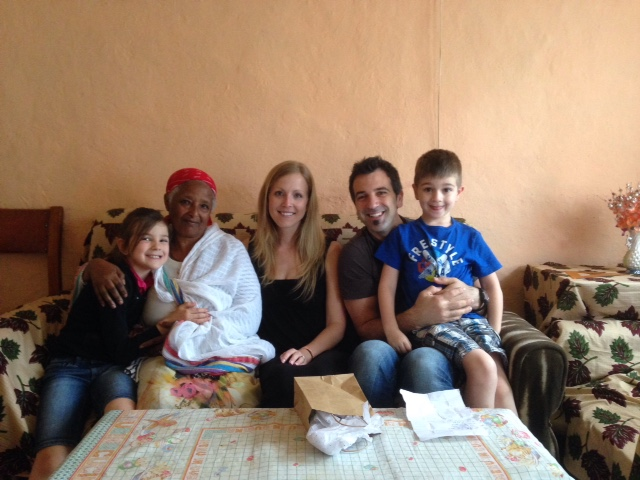 Yaphet's nonna with her arm around Elianna, Gabriel is on Mark's lap and Ruthi is in the middle of it all.