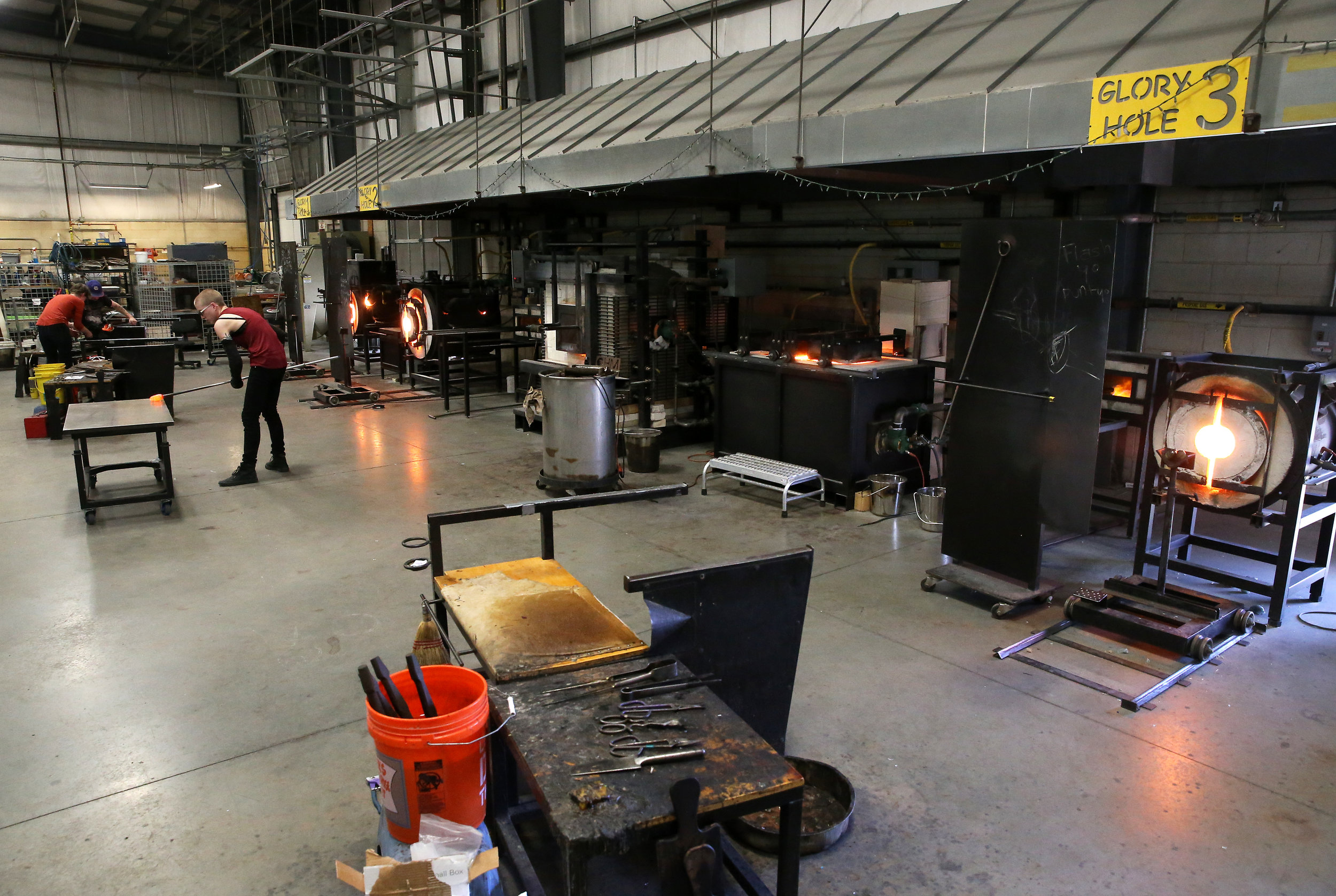 The hot shop is just one of four glass studio areas housed in the Paul J. Stankard Studio Lab; the studio also includes a flame shop, kiln shop, and cold shop covering all areas of studio glass.
