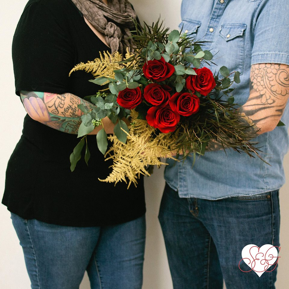 CB&CB's love is terrifically bold, sultry, & fierce -- Featuring premium red long stem roses, gilded plumosa fern, agonis and eucalyptus.