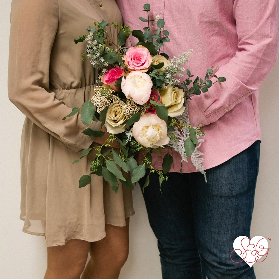 L&M's love is… romantic, classy, & polished -- Featuring ornamental kale, lush peonies & early grey roses, surrounded by seeded eucalyptus.
