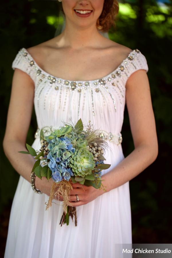 Alexis's bouquet consisted of echeveria, air plants, Dutch hydrangea, silver brunia, & eucalyptus.