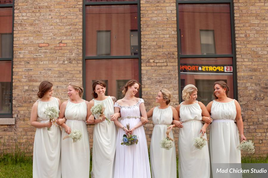 The actual wedding was held at  Clyde Iron Works , a former manufacturing plant turned warm industrial venue and restaurant in Duluth's Lincoln Park neighborhood. Each bridesmaid carried a simple, elegant bouquet of gypsophila. Fun fact: Alexis made each of the bridesmaid's dresses by hand. How cool is that?!?