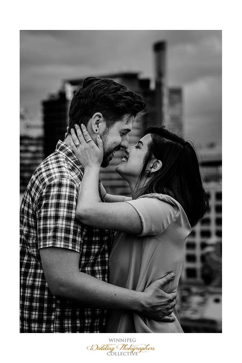 01 Kiss Black and White Rooftop Engagement Session Winnipeg Manitoba Canada Love.jpg