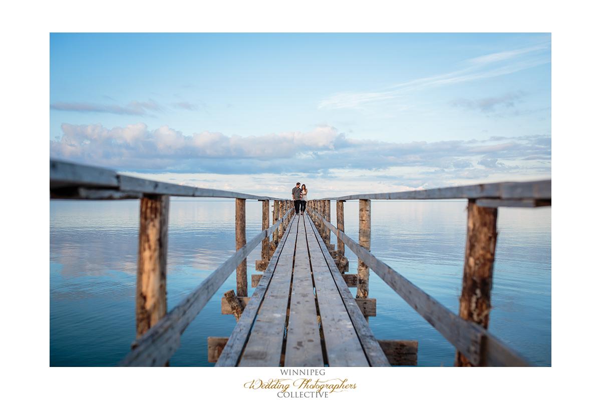 04 Laura and Tyler Lake Life Engagement Shoot Dock Pier Love.jpg