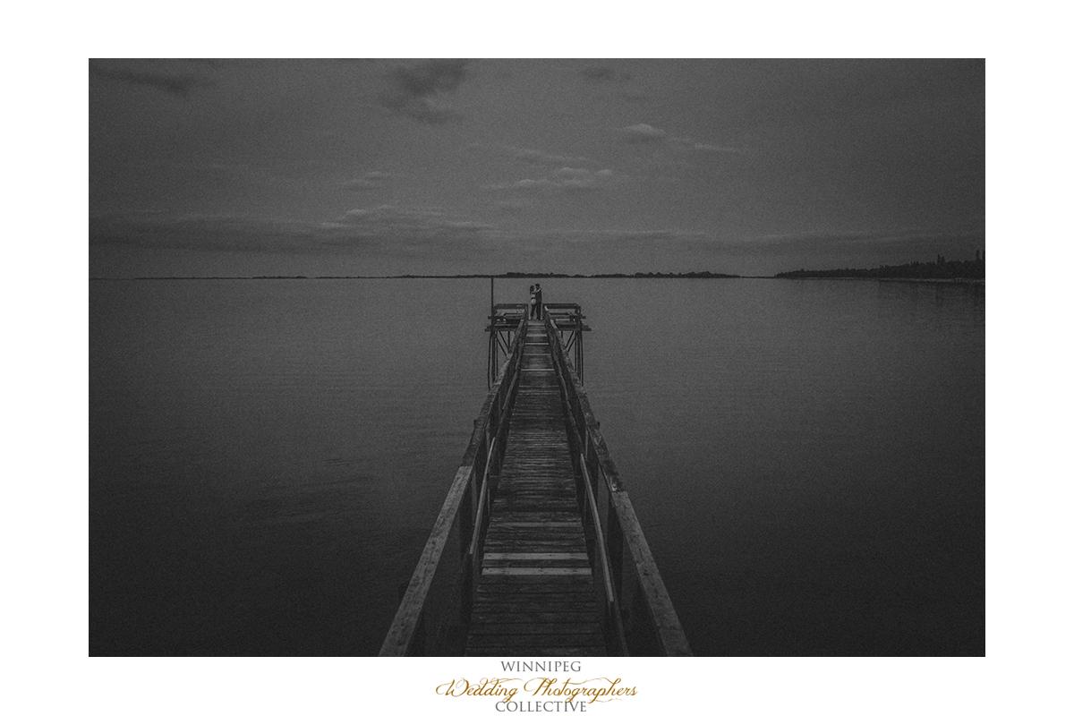 23 Laura and Tyler Lake Life Engagement Shoot Dock Pier Love.jpg