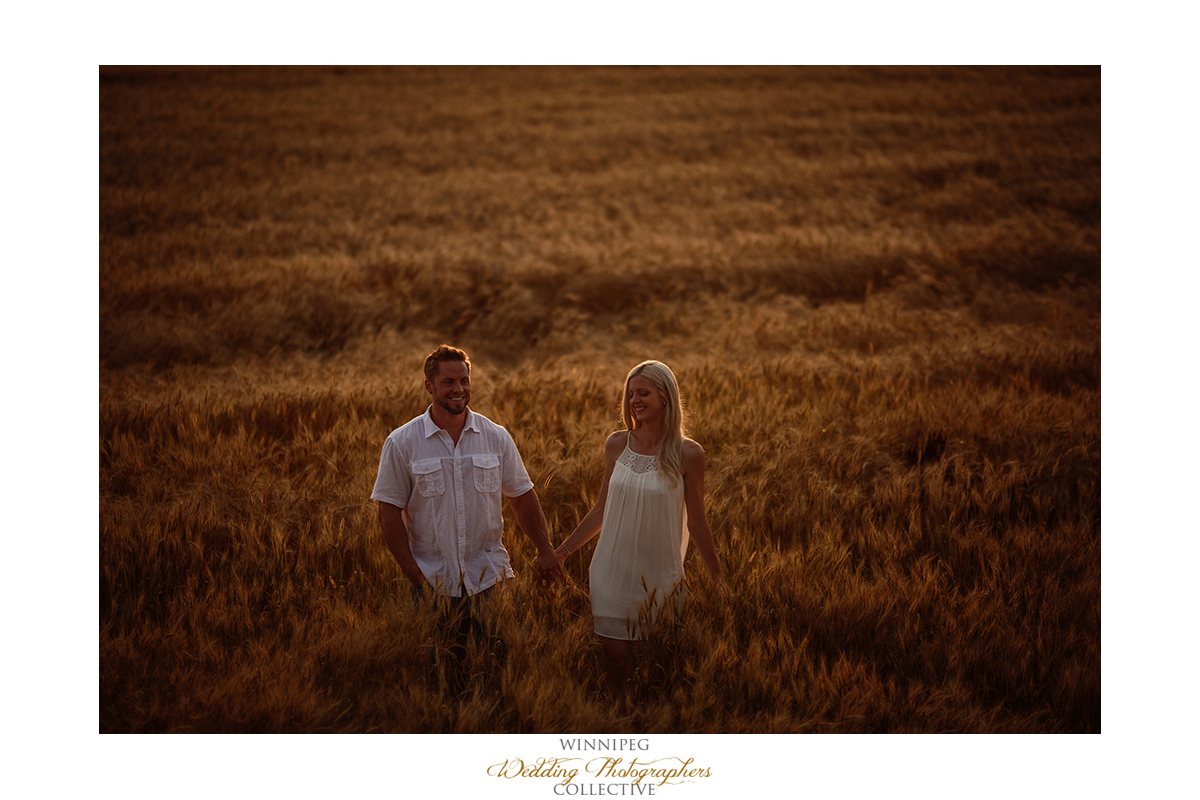 engagement photos in a wheat field Manitoba