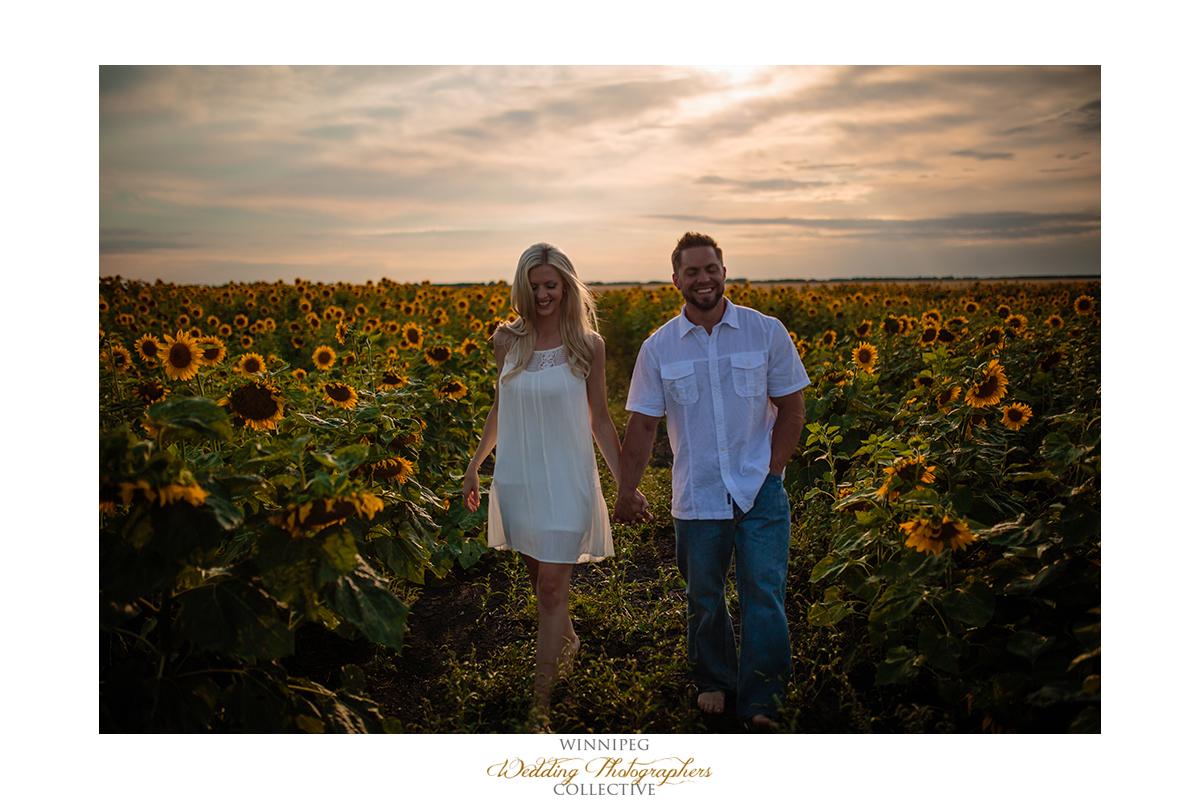 03_Farm Life Engagement Photos Wheat Sunflowers Field Sunset.jpg