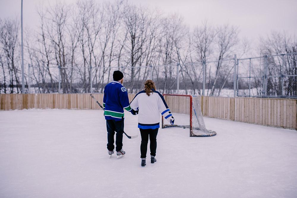 0010jensen-winnipeg-backyard-engagement-skating.jpg