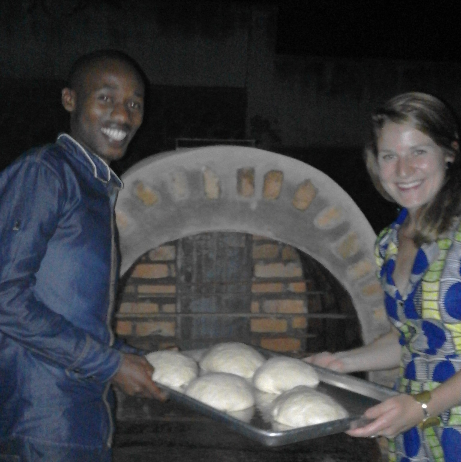 JP, one of the MASS architects for the project, and Meg, East Africa Programs Officer place some TWB loaves in the oven for baking tests! TWB is thrilled at the prospect of a prototype design for the organization and the future of ovens in our bakeries.