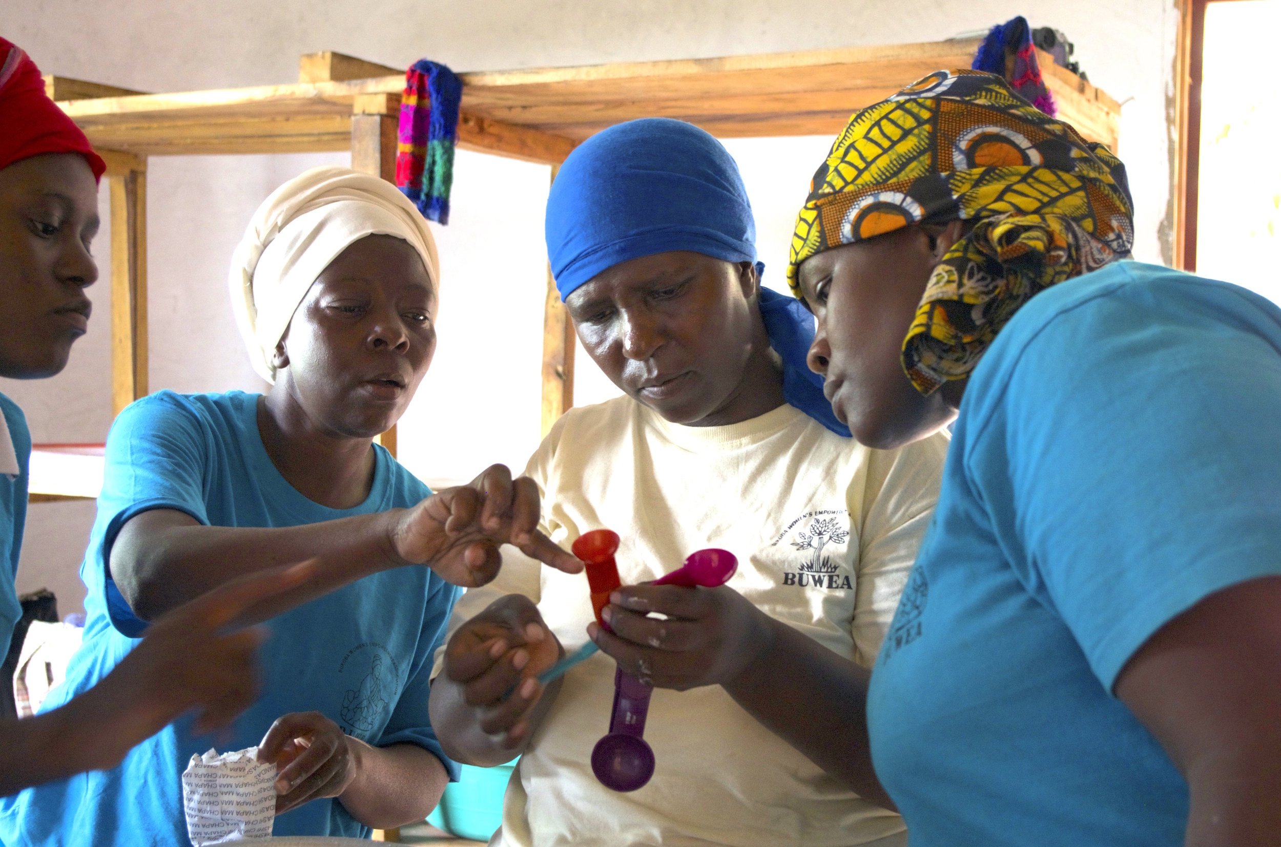 Bukoba_TZ_Learning to use Measuring spoons_Happy and Grace_Mar_2015.jpg