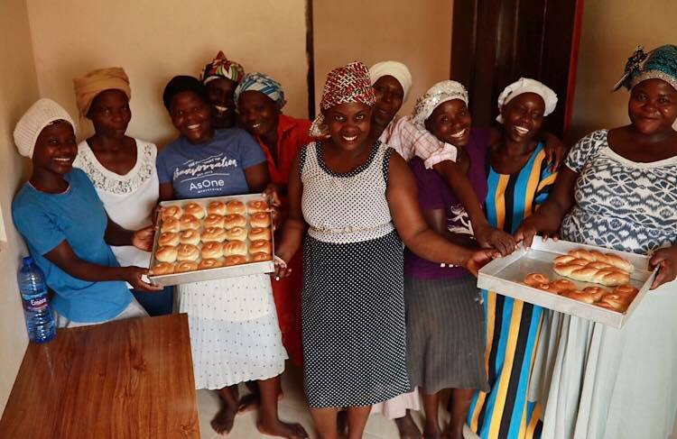 Late september, 2018 - Sylvia, pictured center, was a major part of leadership at the AsOne bakery. In August, she attended our Bakery Operations Manager training to prepare for her role at the new bakery. She leads the team in meeting production and sales goals, monitoring cash flows, and managing a team of bakers.