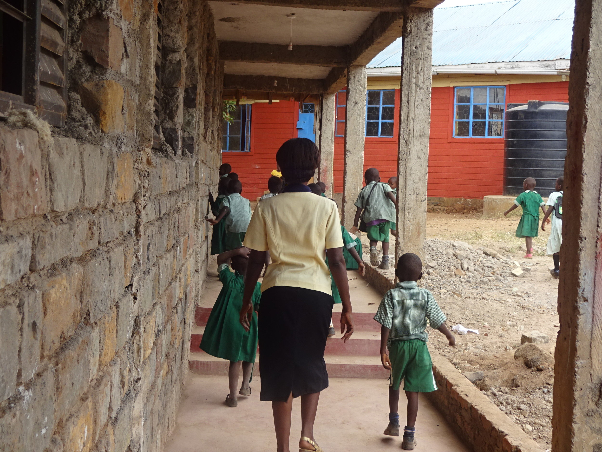 Headteacher Margaret Walking Students to Class