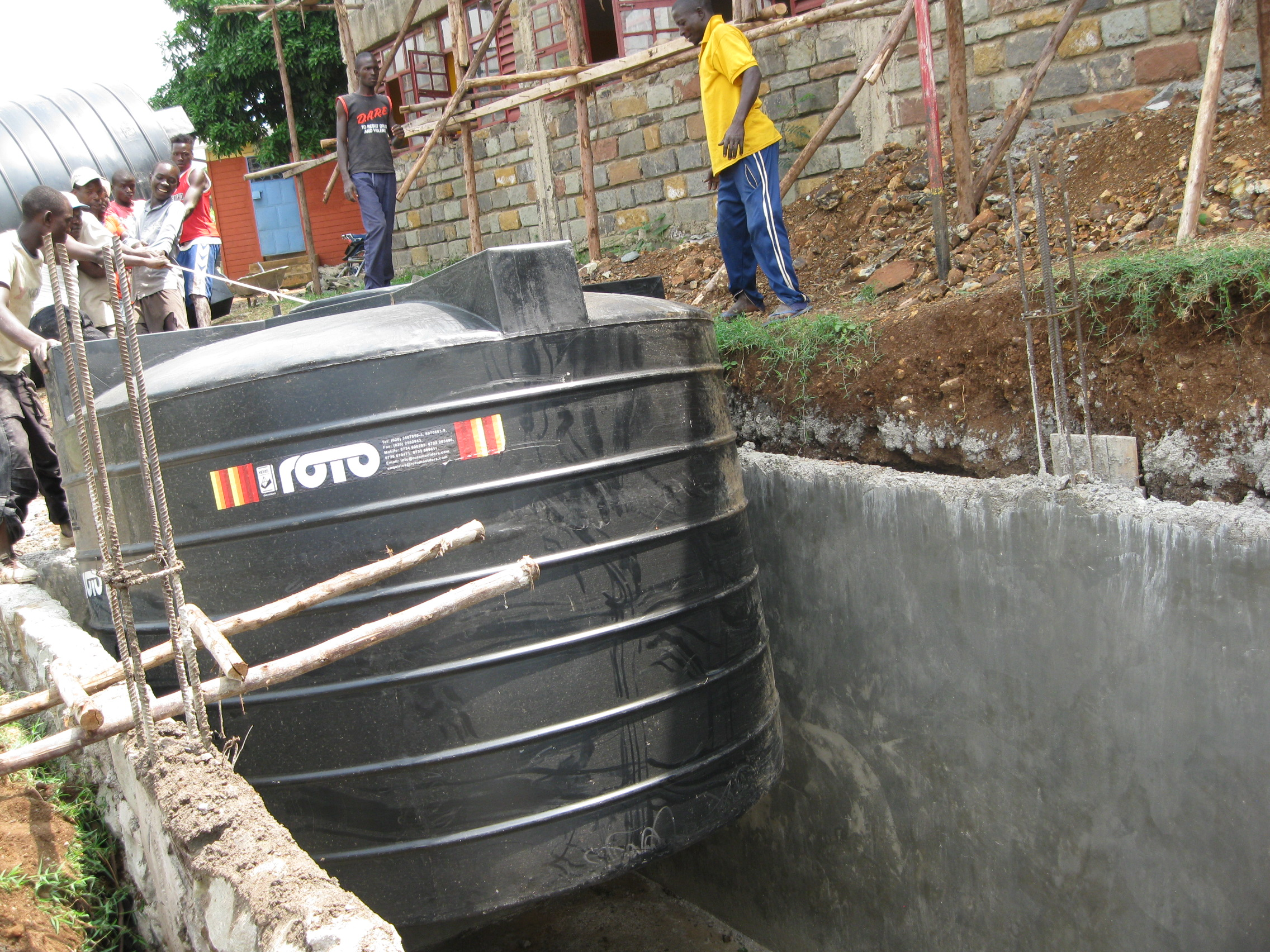 Lowering a Water Cistern into its New Home