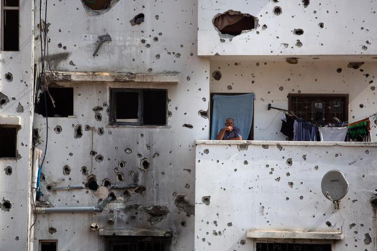 A man awaits Palestinian Prime Minister Rami Hamdallah in theShijaiyah neighborhood of Gaza. Photo courtesy of Khalil Hamra/AP.