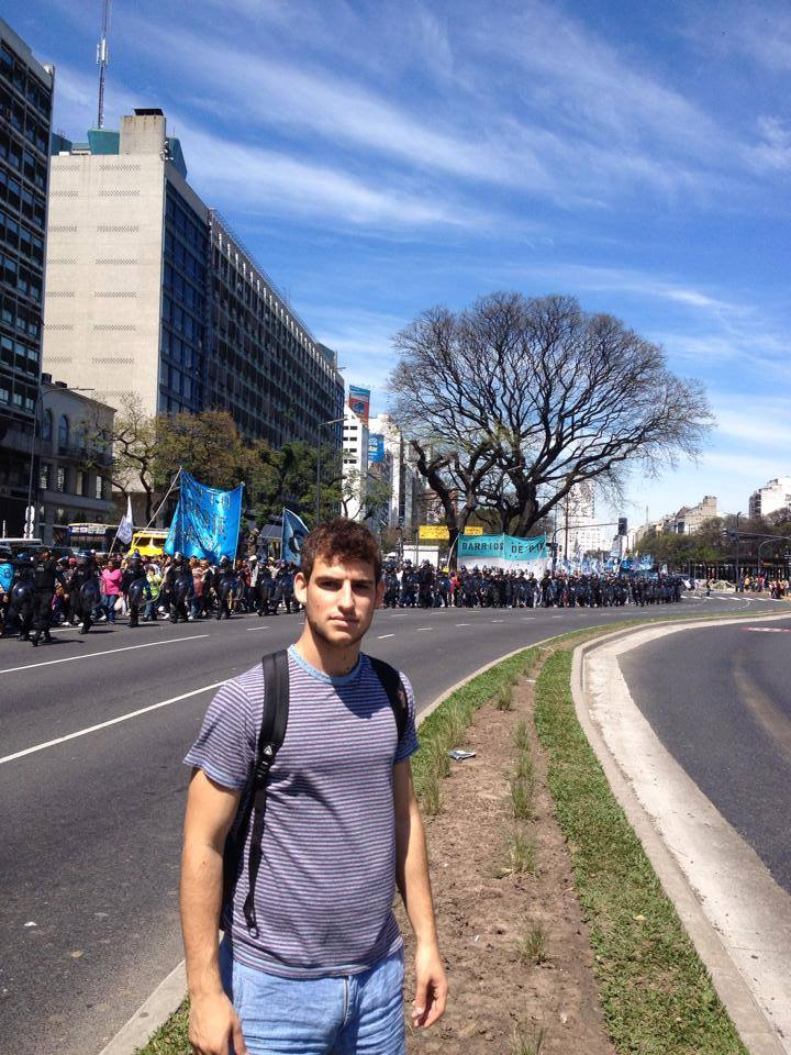 Adam stands in front of a labor protest, a common sight in Buenos Aires where the laborers and government often clash over economic policies.