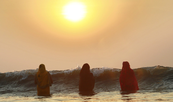 Hindu women pray as the sun sets over the Arabian Sea during the Chhath Puja festival in Mumbai, thanking the Sun God for sustaining life on Earth. Source: The AP