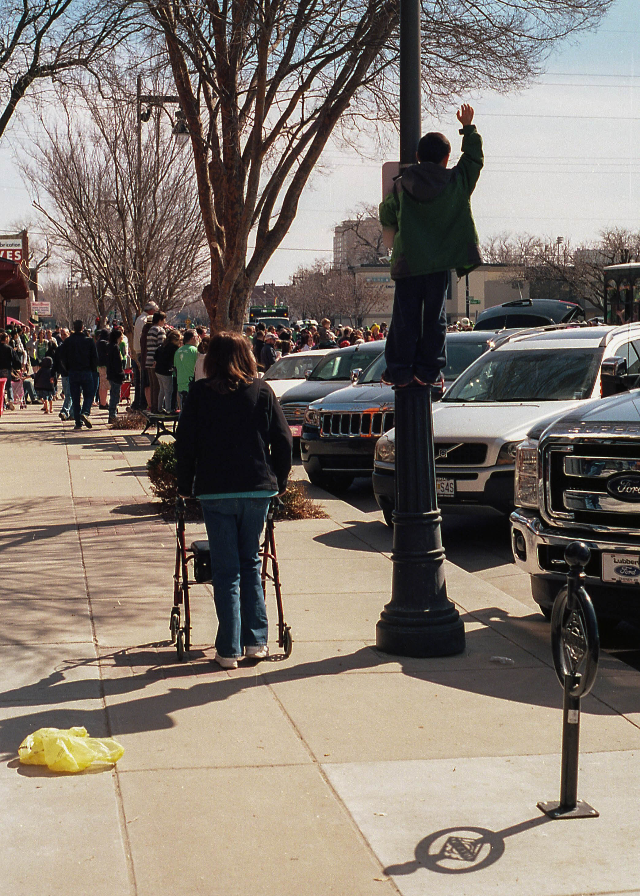Trying to get a view of the parade by any means necessary.