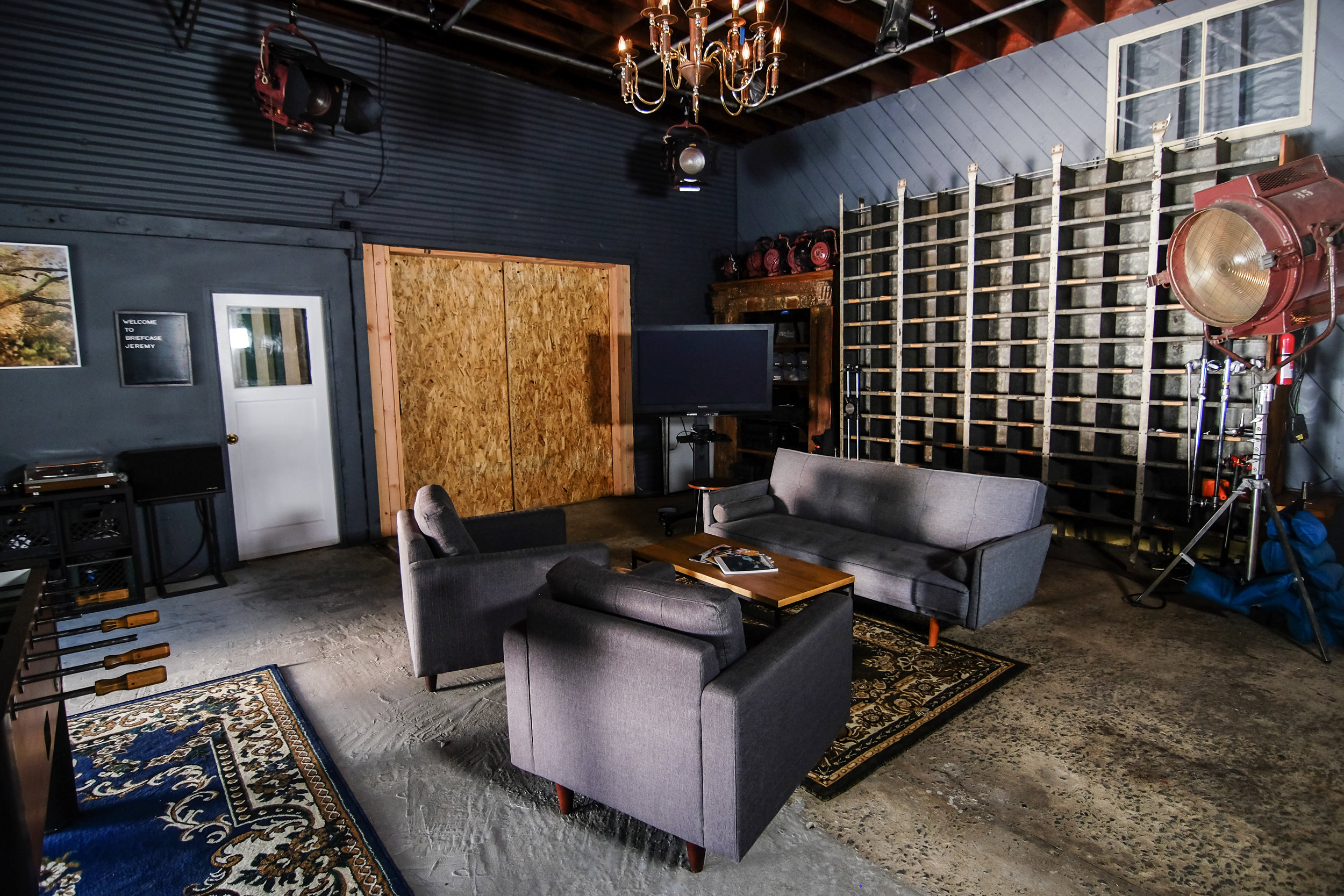 The Lounge / Video Village - (located within main studio)Modern style couch & coffee tableLarge craft bench table on casters2 lounge chairsFoosball table