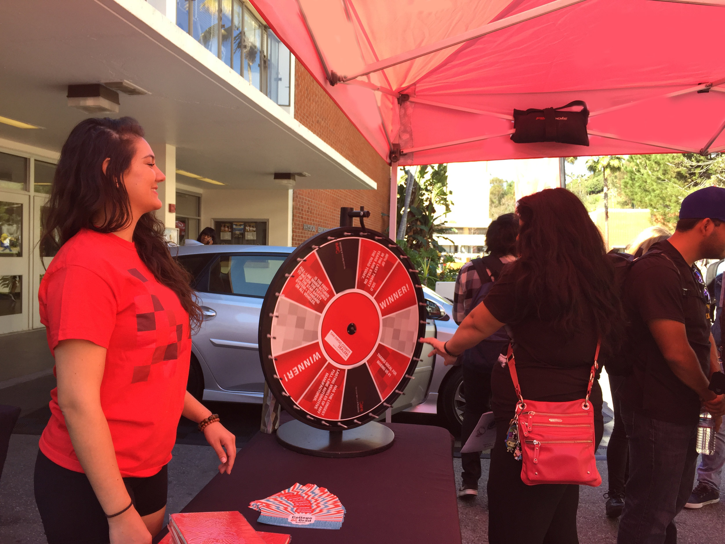 Students gather for the chance to win a prize at the advertisers prize wheel!