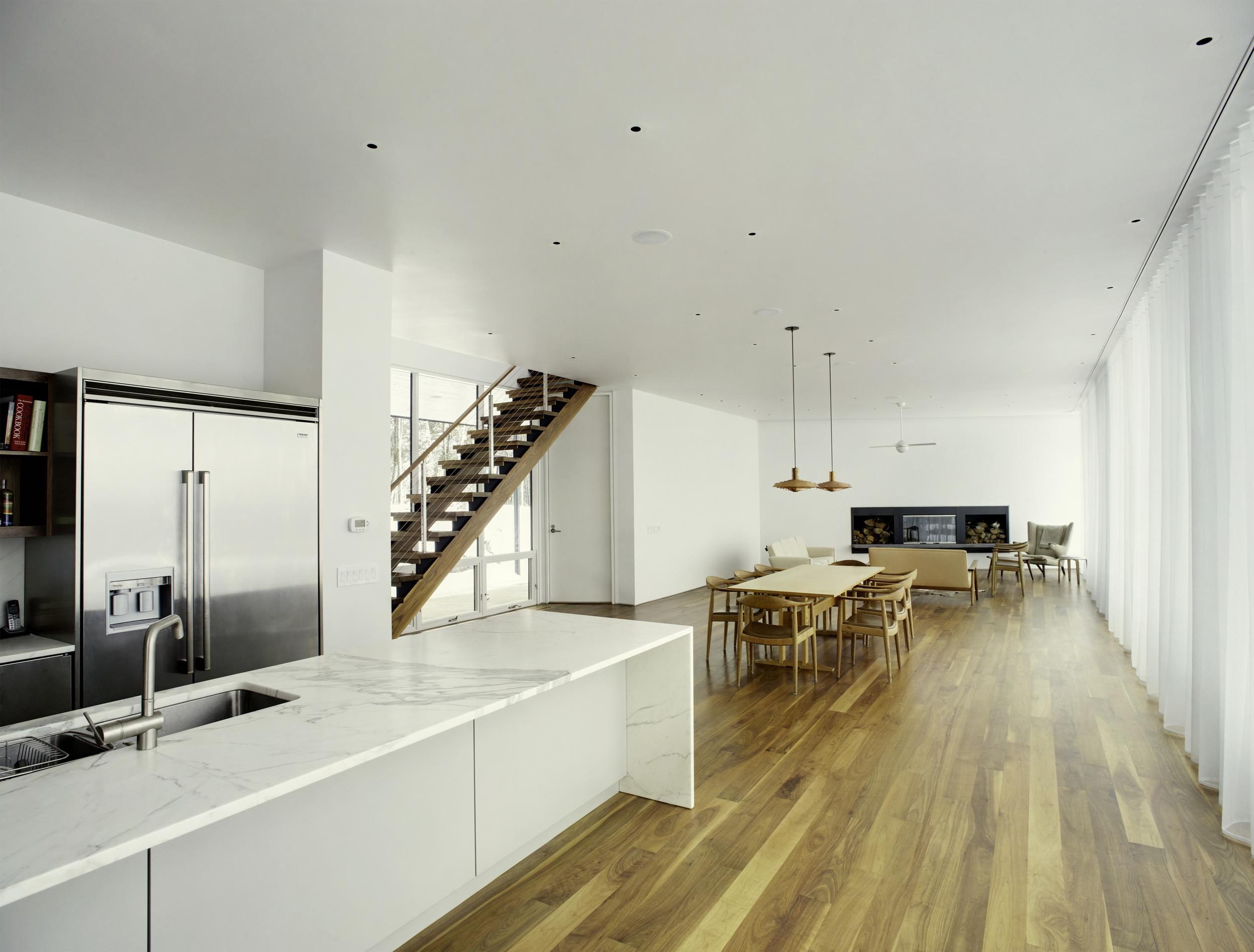 wood floors marble countertops stainless steel kitchen