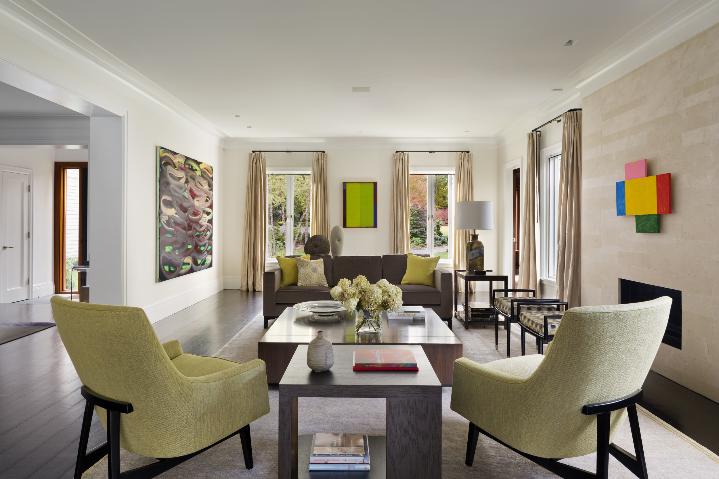 relaxing new england living room with traditional and modern art