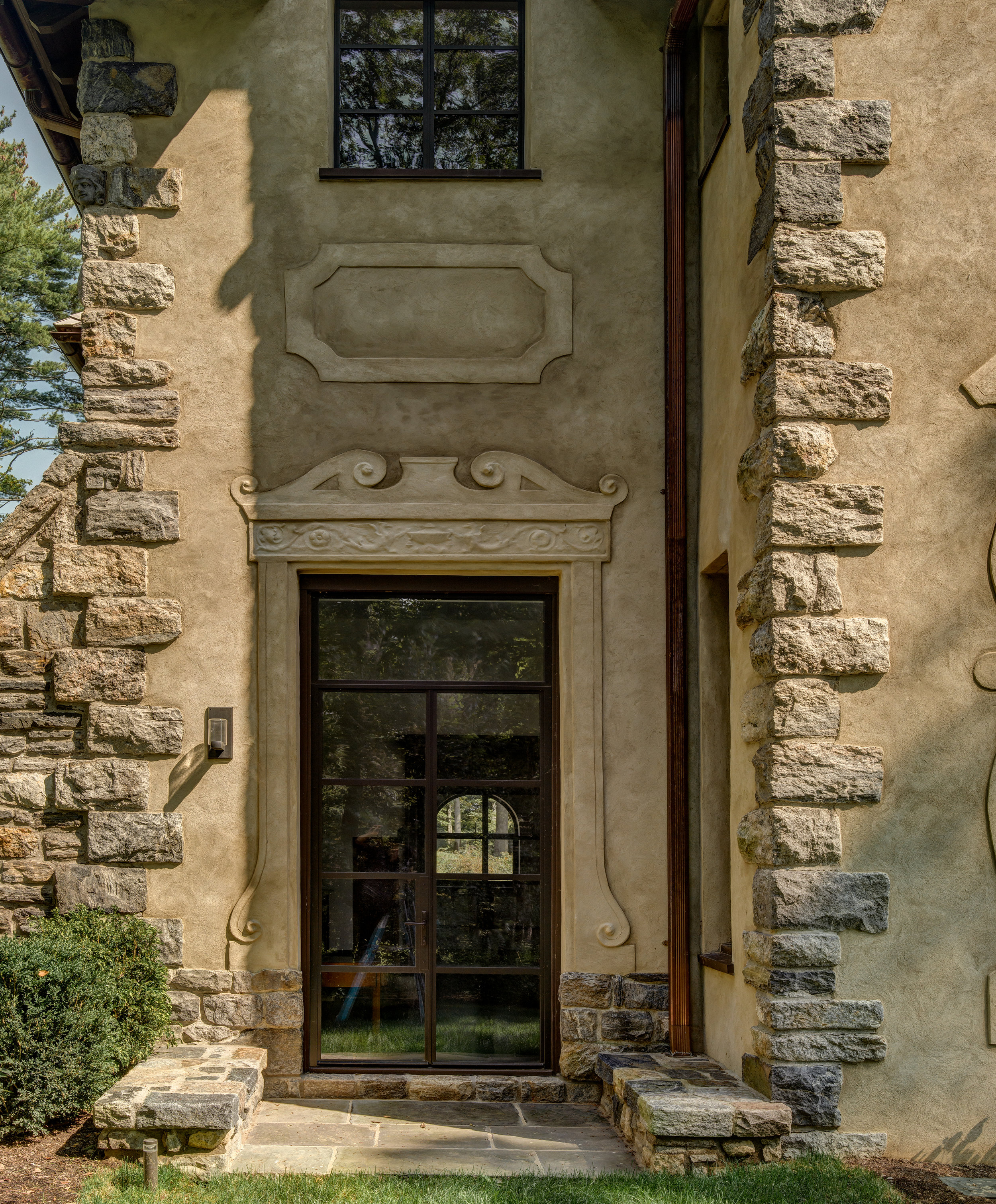 glass door close up detail stone work stucco siding
