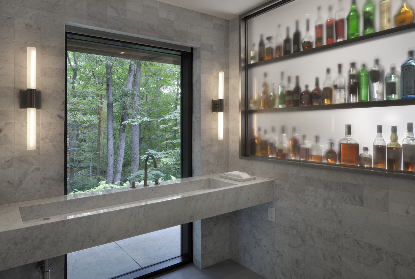 private basement bar with forest views