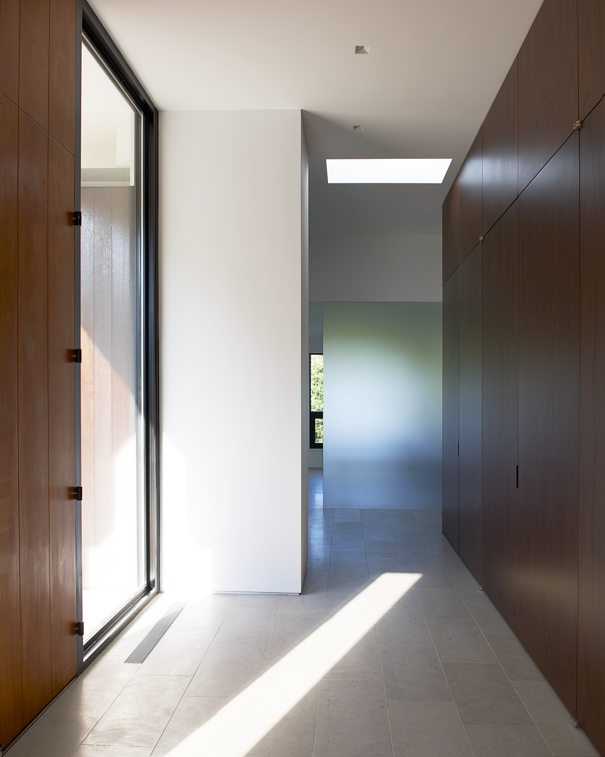 large wood doors hallway bright light