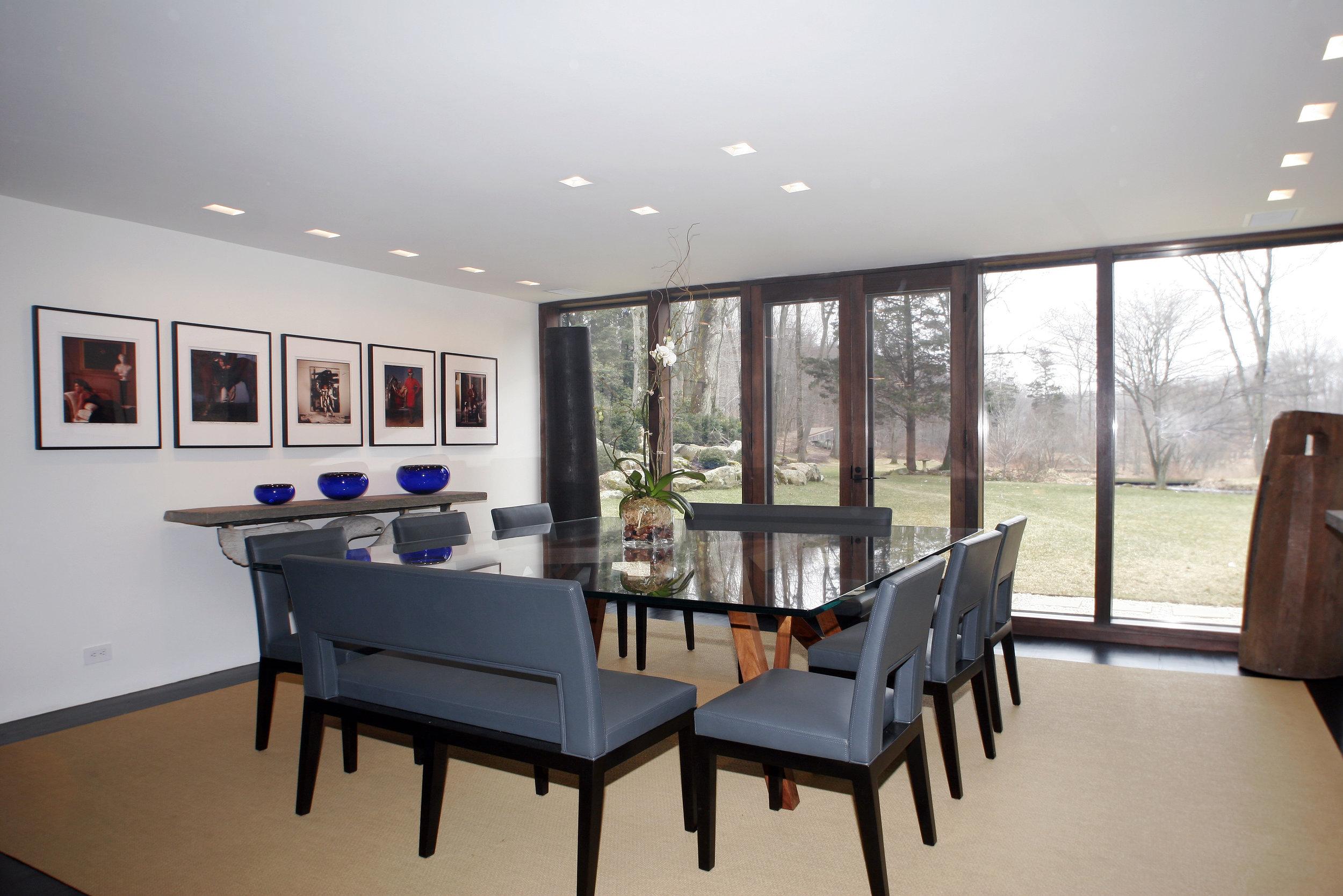 relaxing dining room full length glass windows door