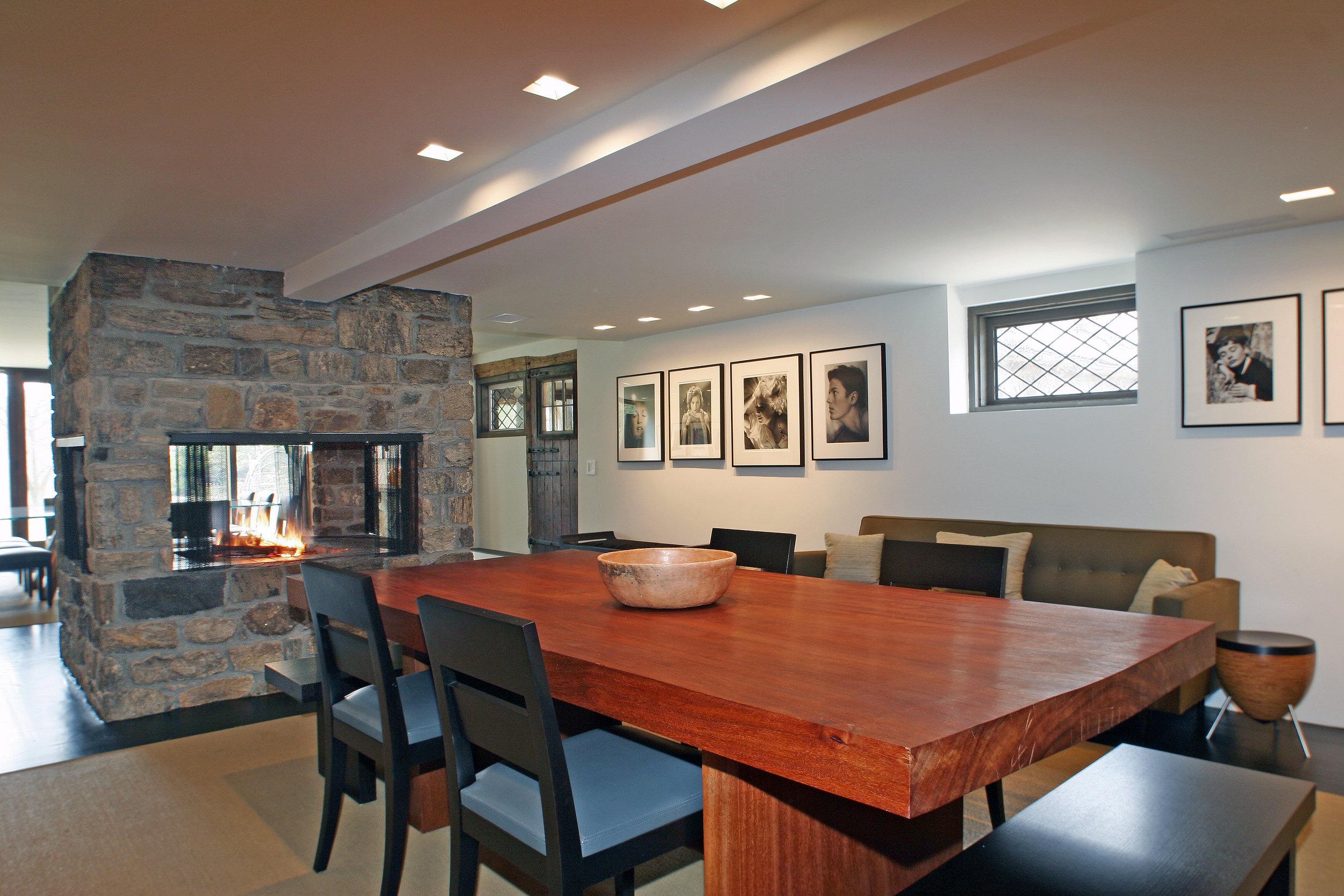 beautiful wood dining room table custom luxury stone fireplace