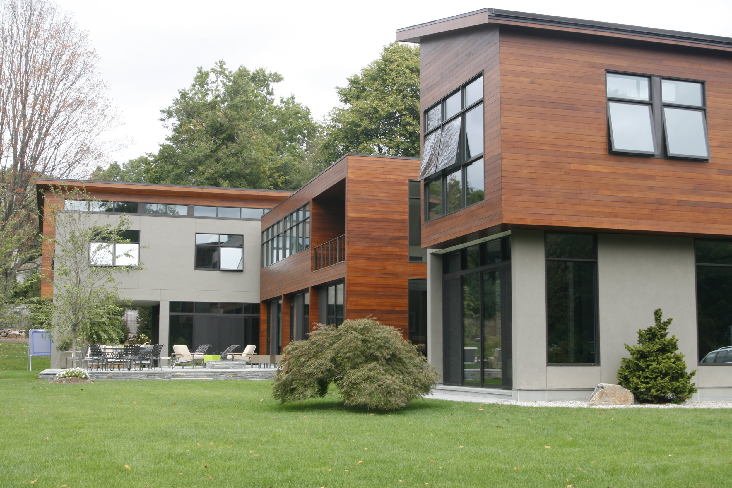 modern architecture stone and wood siding landscaping