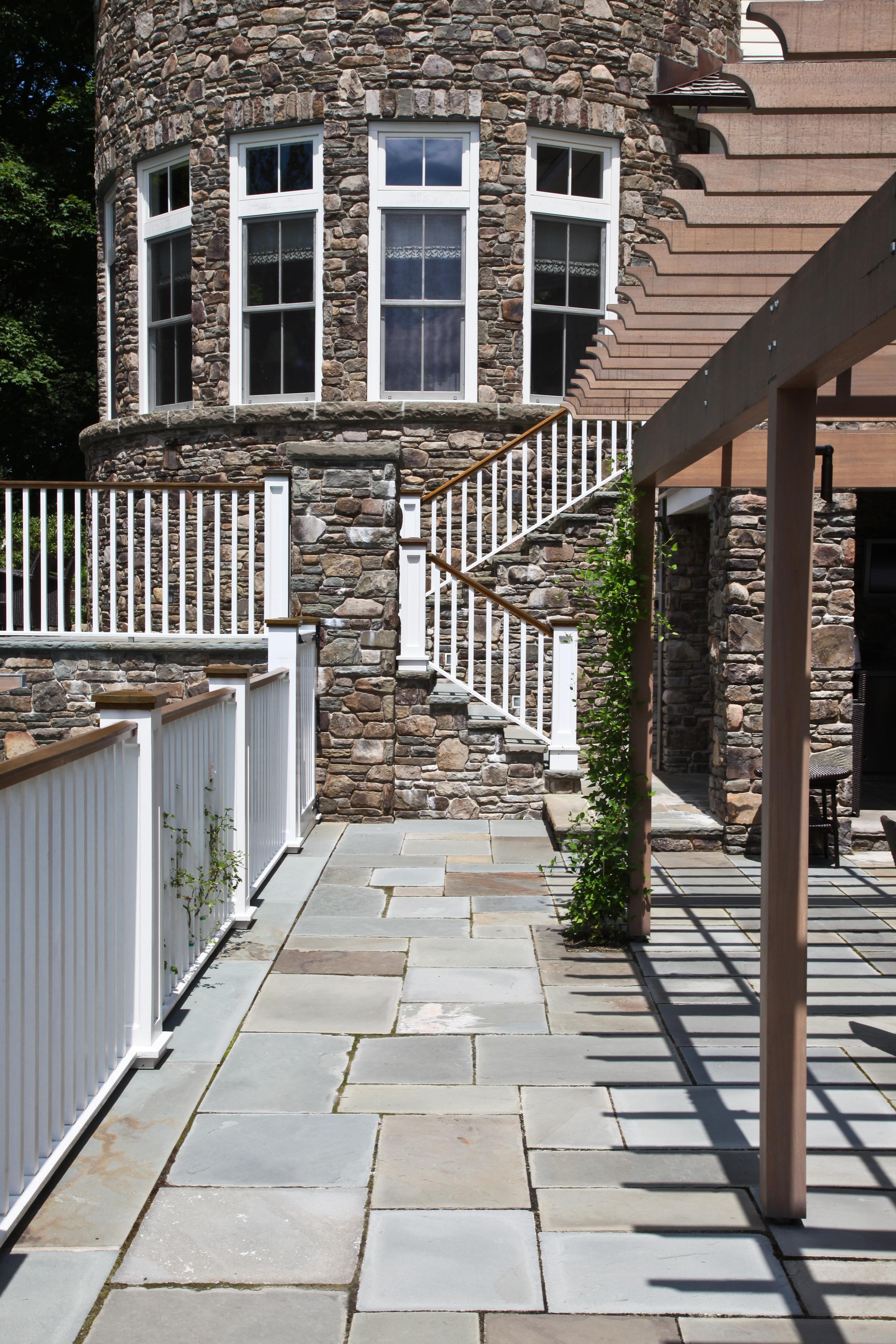 stone poolside walkway fencing