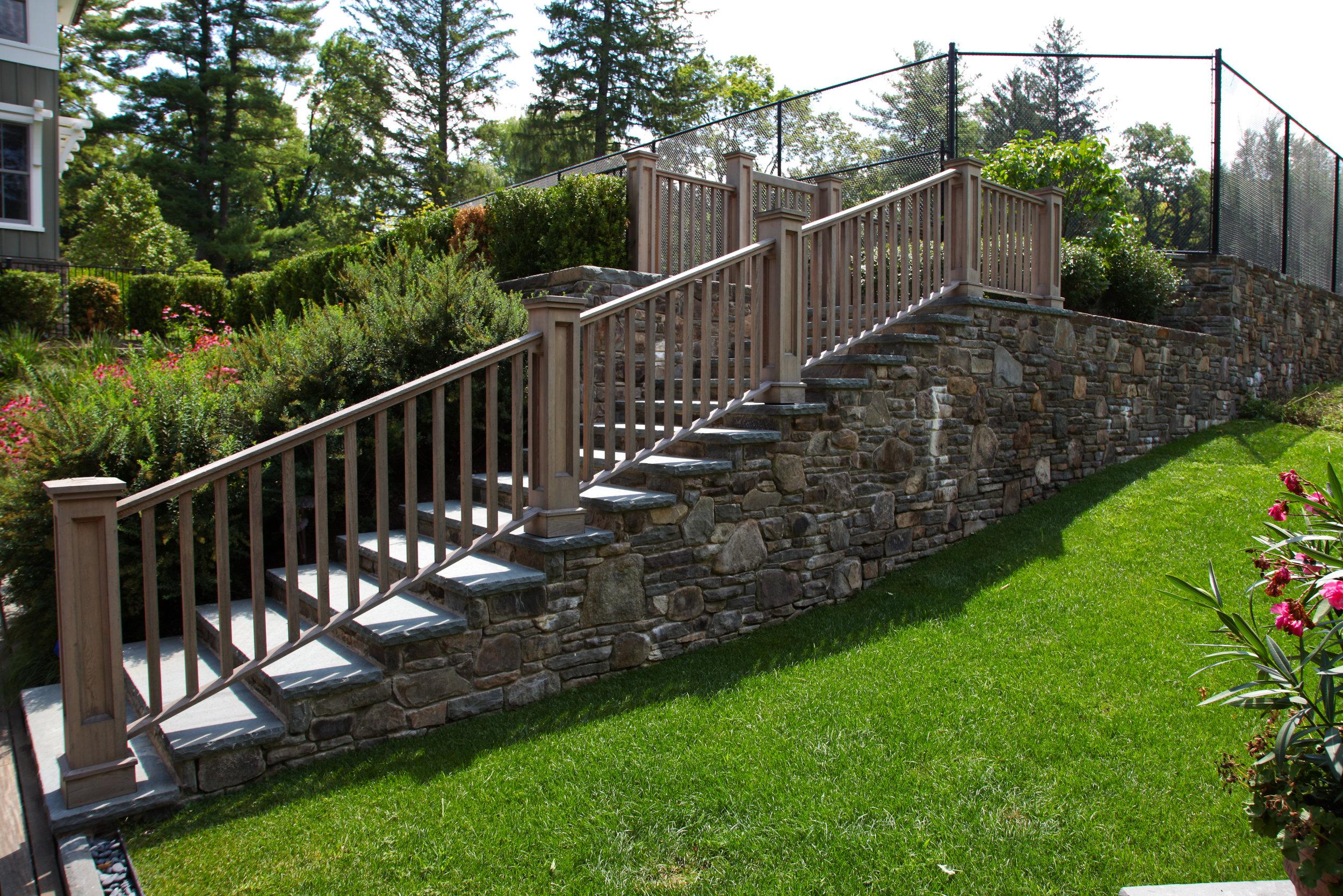 custom stone pool steps tennis courts