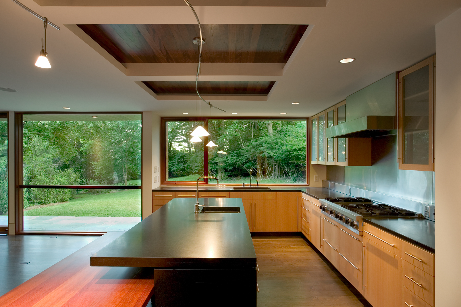 super clean modern kitchen bright large glass windows