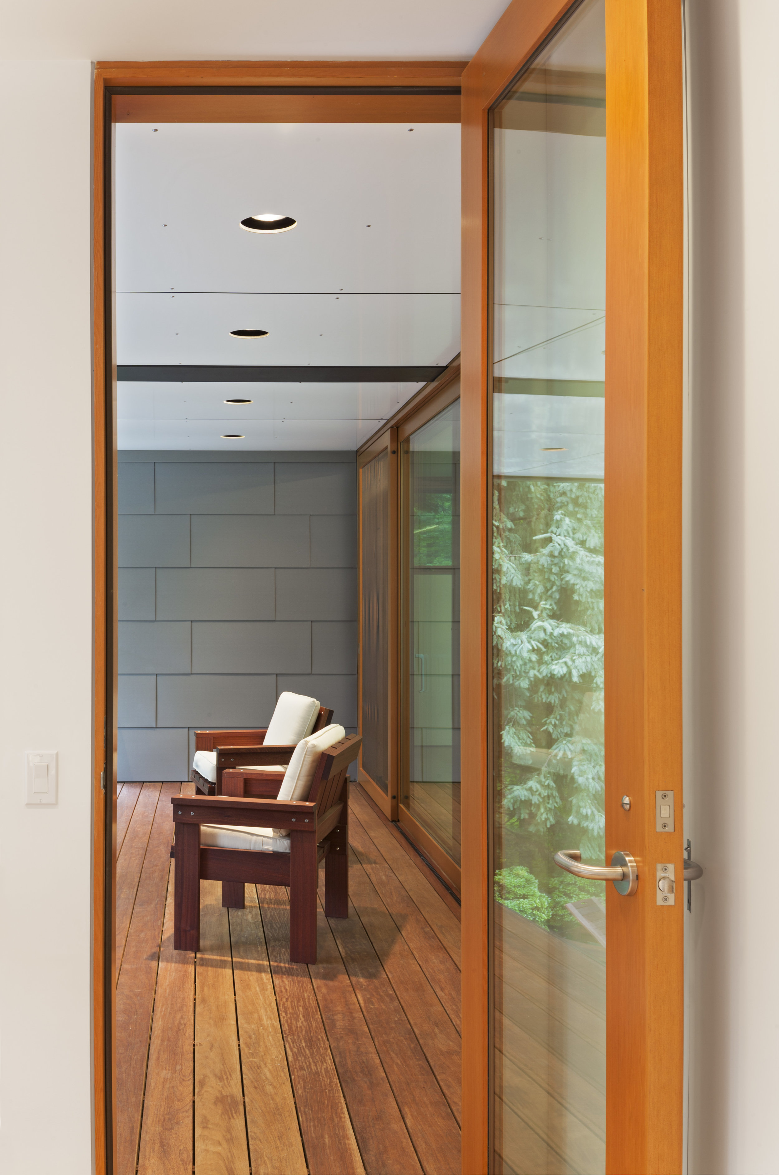 bright glass seating area hallway