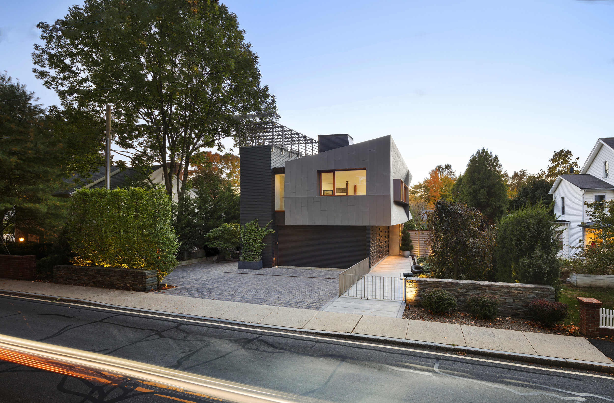 new canaan townhouse during sunset with a rooftop terrace