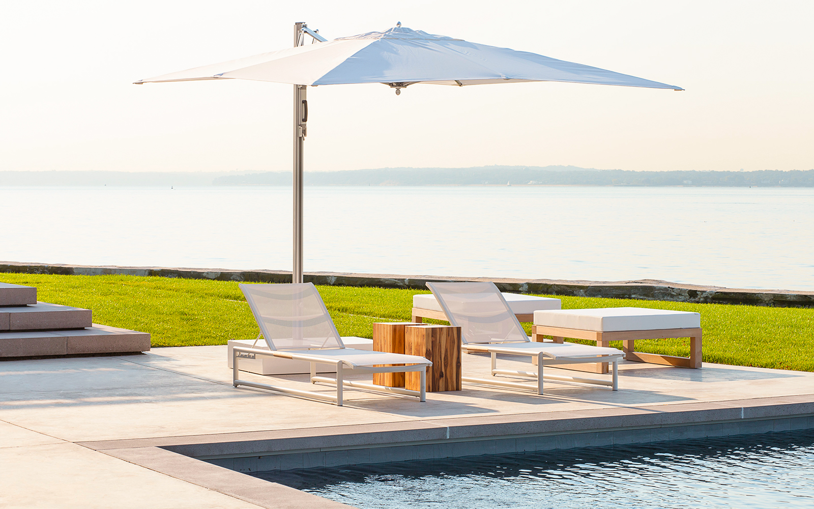 6.Lounge chairs-Umbrella by the water.jpg