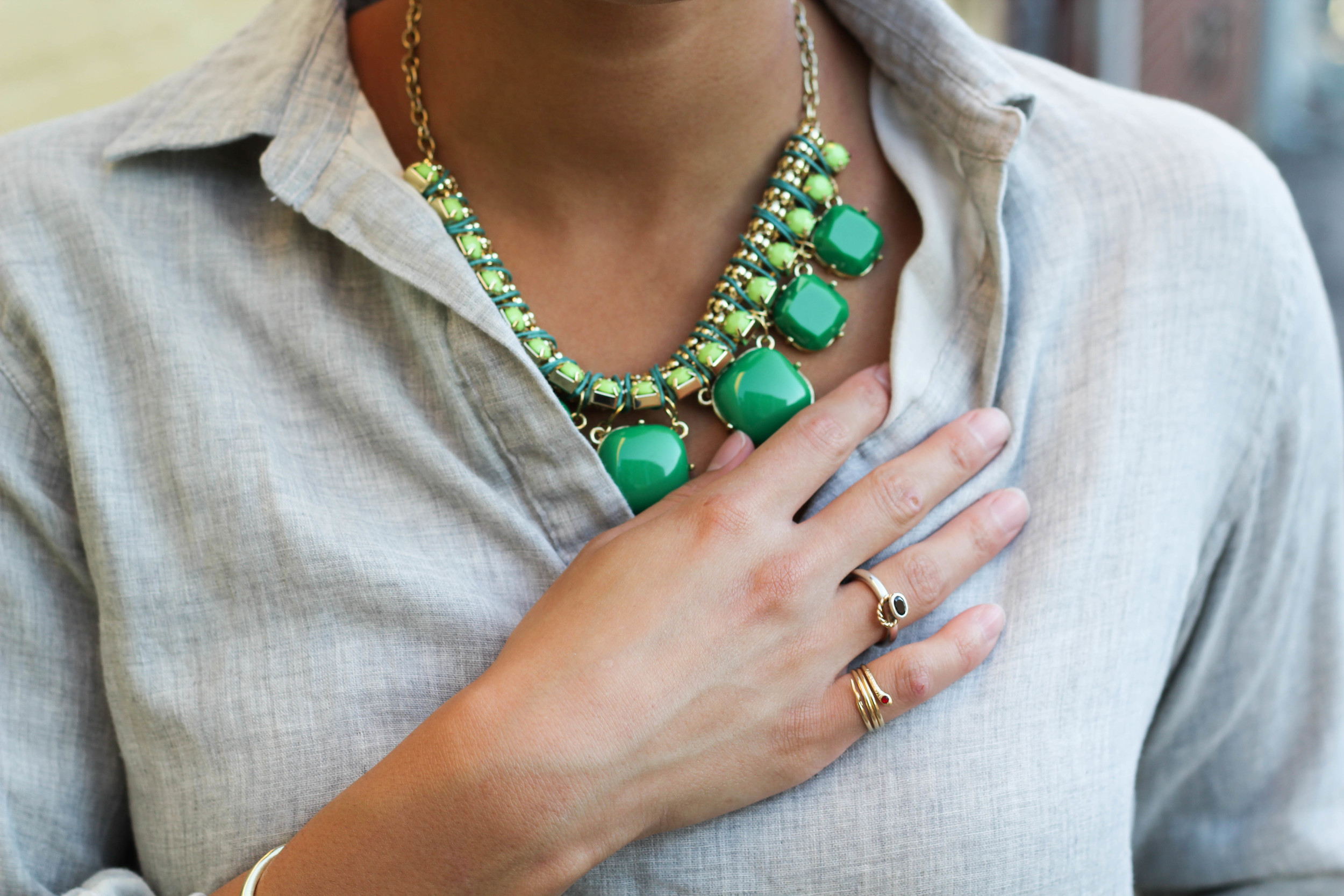 This Necklace is the flare of color that this outfit thrives on. The neutral white and grey colors of the clothing leave room for a statement piece to be thrown in the mix. In this case, it's a chunky, green, and bold necklace. The contrast of the bright against the neutral is a very flattering combination! I also love how the necklace has hints of gold that match with the rings and bracelet. Details, details, and more details!
